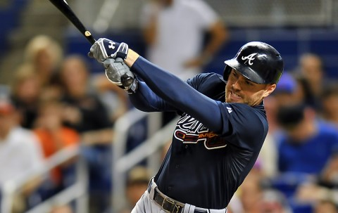 Atlanta Braves first baseman Freddie Freeman (5) connects for a base hit during the first inning against the Miami Marlins at Marlins Park. (Steve Mitchell-USA TODAY Sports)