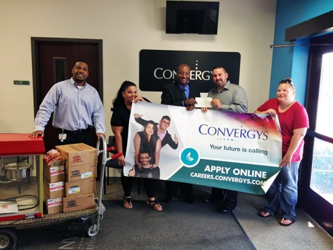Convergys presents LEAP with a $1,000 check.