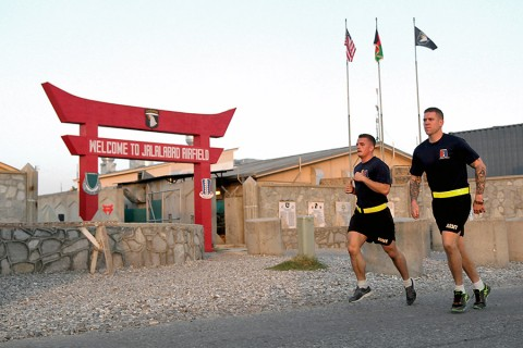 The 3rd BCT, 101st Airborne Division Soldiers run past the Operational Base Fenty entrance in eastern Afghanistan during the Train, Advise, Assist, Command-East Soldier and Noncommissioned Officer of the Year competition, Aug. 5, 2015. (Capt. Charles Emmons, 3rd Brigade Combat Team, 101st Airborne Division (AA) Public Affairs)