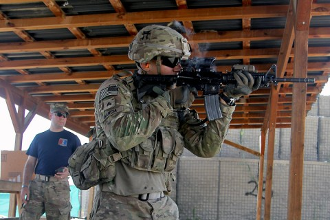 Sgt. Alexandro Garcia, 3rd BCT, 101st Airborne Division, fires his M4 rifle during a stress shoot as part of the Train, Advise, Assist, Command-East Soldier and Noncommissioned Officer of the Year competition in eastern Afghanistan, Aug. 5, 2015. (Capt. Charles Emmons, 3rd Brigade Combat Team, 101st Airborne Division (AA) Public Affairs)