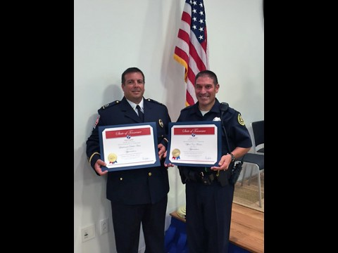 (L to R) Montgomery County Emergency Medical Services Lt. Dustin Haas and Clarksville Police Officer Coz Minetos.