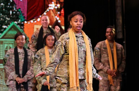 Spc. Princess Threatt, a Soldier from Fort Campbell, Ky., sings and performs during 2015 U.S. Army Soldier Show held at Statyon Theater here on Fort Bliss, Texas, Aug. 28. Threatt began singing at the age of 4 and is an accomplished dancer and pianist. (Julia Redding, 24th Press Camp Headquarters)