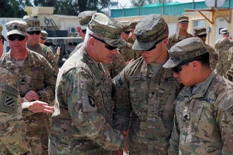 Gen. John F. Campbell, commander of Resolute Support and U.S. Forces Afghanistan, shakes hands with 3rd BCT, 101st Airborne Division Soldiers present for the dedication of a medical clinic named for their fallen platoon medic, Sept. 17th, 2015, in eastern Afghanistan. The Corporal John M. Dawson Medical Clinic was dedicated to a 3rd BCT, 101st Airborne Division medic who was killed in an insider attack April 8th, 2015, in Nangarhar province. (Capt. Charles Emmons, 3rd Brigade Combat Team, 101st Airborne Division (AA) Public Affairs)