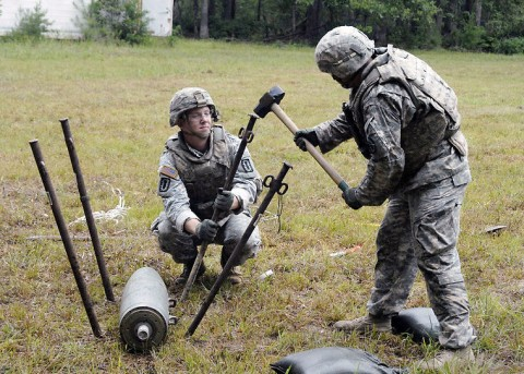 During the 2014 Explosive Ordnance Disposal Team of the Year competition at Fort A.P. Hill, Soldiers from the 732nd EOD Company, 52nd Ord. Group, Fort Campbell, Ky., secure an inert bomb to ensure it will not move during diffusing procedures. It was one of 14 tasks teams were asked to perform during the competition. (Courtesy Photo)
