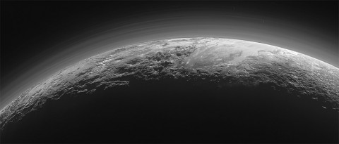 Pluto's Majestic Mountains, Frozen Plains and Foggy Hazes: Just 15 minutes after its closest approach to Pluto on July 14, 2015, NASA's New Horizons spacecraft looked back toward the sun and captured this near-sunset view of the rugged, icy mountains and flat ice plains extending to Pluto's horizon. (NASA/JHUAPL/SwRI)
