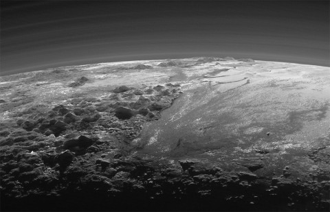 Closer Look: Majestic Mountains and Frozen Plains: Just 15 minutes after its closest approach to Pluto on July 14, 2015, NASA's New Horizons spacecraft looked back toward the sun and captured this near-sunset view of the rugged, icy mountains and flat ice plains extending to Pluto's horizon. (NASA/JHUAPL/SwRI)