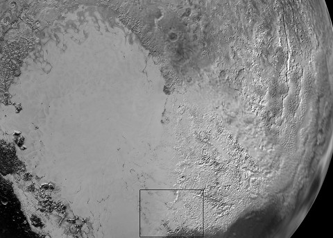 Pluto's 'Heart': Sputnik Planum is the informal name of the smooth, light-bulb shaped region on the left of this composite of several New Horizons images of Pluto. The brilliantly white upland region to the right may be coated by nitrogen ice that has been transported through the atmosphere from the surface of Sputnik Planum, and deposited on these uplands. The box shows the location of the glacier detail images below. (NASA/JHUAPL/SwRI)