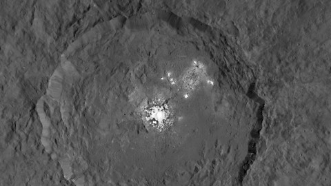 This image, made using images taken by NASA's Dawn spacecraft, shows Occator crater on Ceres, home to a collection of intriguing bright spots. (NASA/JPL-Caltech/UCLA/MPS/DLR/IDA)