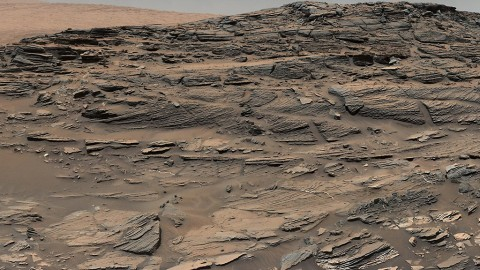 Large-scale crossbedding in the sandstone of this ridge on a lower slope of Mars' Mount Sharp is typical of windblown sand dunes that have petrified. (NASA/JPL-Caltech/MSSS)