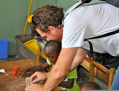 Simon Lawrence, working with a child in Uganda.