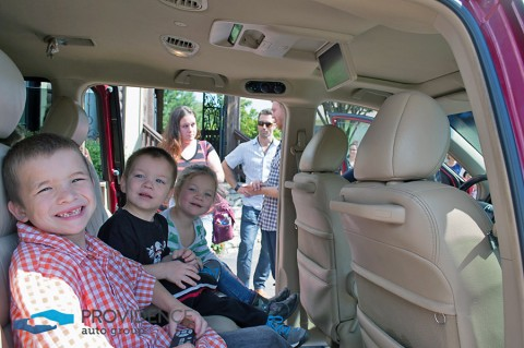 Children Checking Out their New Car.