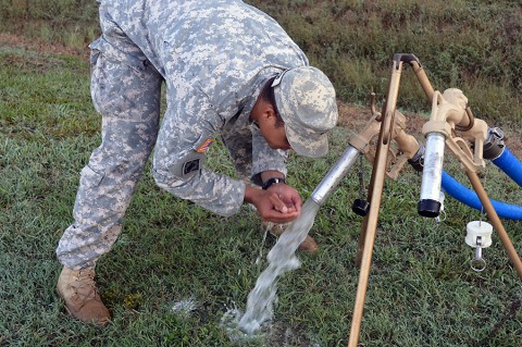 Spc. Deaughn Clinton, a petroleum supply specialist with the 129th Combat Sustainment Support Battalion, 101st Airborne Division Sustainment Brigade, samples newly-purified stream water at the intermediate staging base at the Joint Readiness Training Center, Fort Polk, La., Sept. 23, 2015. (Maj. Ireka Sanders, 2nd Brigade Combat Team, 101st Airborne Division (Air Assault) Public Affairs)