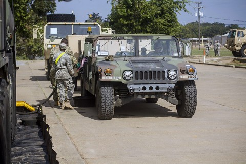 Soldiers stop to fuel up their vehicle before staging them at the ground assault convoy at the intermediate staging base in support of 2nd Brigade Combat Team, 101st Airborne Division's Joint Readiness Training Center rotation 16-01 at Fort Polk, La., Sept. 24, 2015. The vehicles are stored here until the order is given to move into the training area, simulating a deployed environment. (Staff Sgt. Terrance D. Rhodes, 2nd Brigade Combat Team, 101st Airborne Division (Air Assault) Public Affairs)