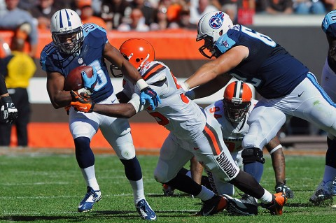Tennessee Titans running back Bishop Sankey (20) runs the ball as Cleveland Browns middle linebacker Karlos Dansby (56) makes the tackle during the second half at FirstEnergy Stadium. The Browns won 28-14. (Mandatory Credit: Ken Blaze-USA TODAY Sports)