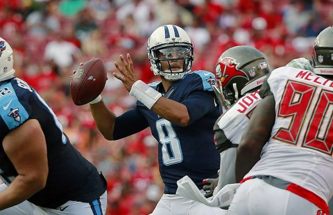 Tennessee Titans quarterback Marcus Mariota (8) throws the ball against the Tampa Bay Buccaneers during the second half at Raymond James Stadium. Tennessee Titans defeated the Tampa Bay Buccaneers 42-14 on September 13th, 2015. (Kim Klement-USA TODAY Sports)