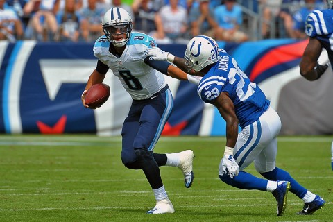 Tennessee Titans quarterback Marcus Mariota (8) scrambles to avoid Indianapolis Colts strong safety Mike Adams (29) during the first half at Nissan Stadium. (Jim Brown-USA TODAY Sports)
