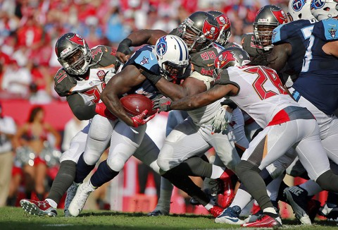 Tampa Bay Buccaneers defensive tackle Clinton McDonald (98) tackles Tennessee Titans running back Terrance West (35) during the first half at Raymond James Stadium. (Kim Klement-USA TODAY Sports)