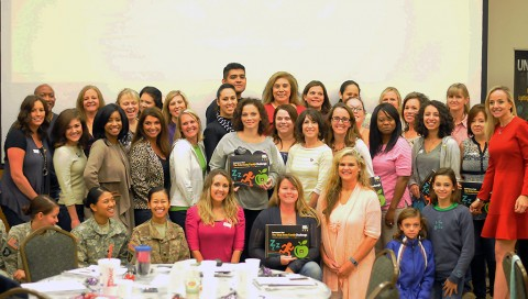 """Family members with the 2nd Brigade Combat Team, 101st Airborne Division (Air Assault) pose for a photo during the """"spark your inner fire"""" workshop at the Family Resource Center, Sept. 30, 2015. (U.S. Army Staff Sgt. Sierra A. Fown, 2nd Brigade Combat Team, 101st Airborne Division (Air Assault) Public Affairs)"""