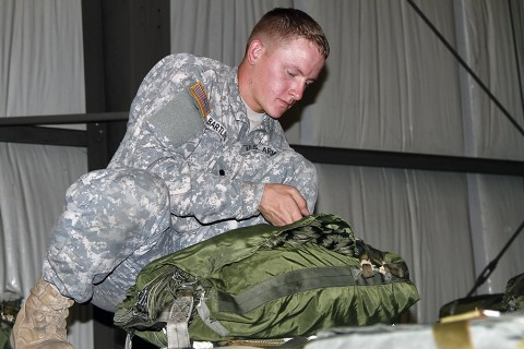 Spc. Wylie Bartling with the 372nd Inland Cargo Transfer Company, 129th Combat Sustainment Support Battalion, 101st Airborne Division Sustainment Brigade prepares an aerial delivery bundle Sept. 30, 2015, at England Airfield in Alexandria, La. Delivery bundles will ensure Soldiers, with the 2nd Brigade Combat Team, 101st Airborne Division (Air Assault), in training areas receive supplies to conduct various missions for Soldier readiness and mission success during their Joint Readiness Training Center rotation at Fort Polk, LA. (Sgt. 1st Class Mary Rose Mittlesteadt, 101st Airborne Division Sustainment Brigade public affairs)