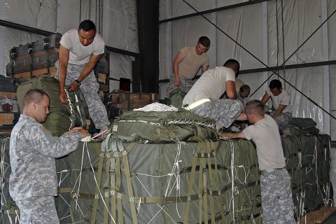 Soldiers from the 101st Airborne Division Sustainment Brigade and 2nd Brigade Combat Team, 101st Airborne Division (Air Assault) prepare aerial delivery bundles Sept. 30, 2015, at England Airfield in Alexandria, La. Delivery bundles will ensure Soldiers, with the 2nd Brigade Combat Team, 101st Airborne Division (Air Assault), in training areas receive supplies to conduct various missions for Soldier readiness and mission success during their Joint Readiness Training Center rotation at Fort Polk, LA. (Sgt. 1st Class Mary Rose Mittlesteadt, 101st Airborne Division Sustainment Brigade public affairs)