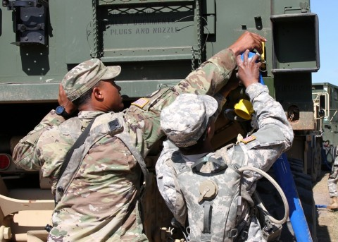 Sgt. Tony Clinton and Spc. Natalie Smith, both water purification specialist from 129th Combat Sustainment Support Battalion, 101st Airborne Division Sustainment Brigade (Lifeliners), 101st Airborne Division (Air Assault), hook a hose onto a Load Handling System Compatible Water Tank Rack (Hippo) to fill it with water that was purified through the tactical water purification system (TWPS), on Sept. 3, 2015, at the Joint Readiness Training Center's Intermediate Staging Base in Alexandria, Louisiana. (U.S. Army Photo by Sgt. 1st Class Mary Rose Mittlesteadt, 101st Airborne Division Sustainment Brigade (Lifeliners) Public Affairs)