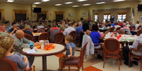 Soldiers, Family and Veterans of the 5th Special Forces Group (Airborne), listen to Dr. Stu Weber, an author and former Captain in the 5th SFG(A), during the 54th Reunion prayer breakfast at the Oasis Dining Facility on Sept. 16, 2015, at Fort Campbell, Ky.