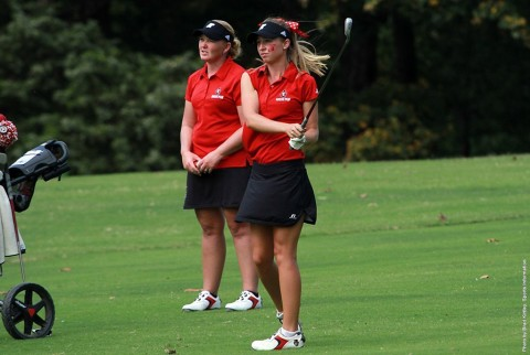 With Austin Peay Women's Golf head coach Sara Robson observing, Jessica Cathey fires a shot on the final hole, Monday, in the F&M Bank APSU Intercollegiate. (APSU Sports Information)
