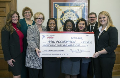 Chapter officers present APSU President Dr. Alisa White with a check.