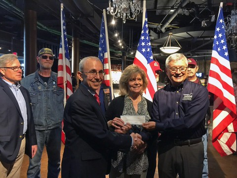 Mike Goodwin, Project Director for Campbell Crossing, presents a check to Nashville Connection- Heroes Salute on behalf of the Lend Lease (US) Community Fund.