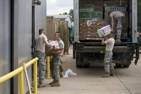 Food service specialist and kitchen police from 2nd Brigade Combat Team, 101st Airborne Division (Air Assault) and supporting units unload fresh fruit into a walk-in freezer at the intermediate staging base at Fort Polk, La., Sept. 25, 2015. (Staff Sgt. Terrance D. Rhodes, 2nd Brigade Combat Team, 101st Airborne Division (Air Assault) Public Affairs)