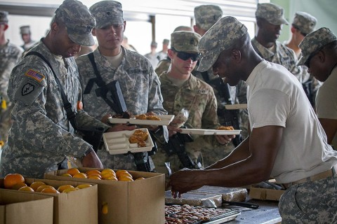 Sgt. 1st Class Trerilski Davis, the culinary management noncommissioned officer, from Wadley, Ga., with Company E, 39th Brigade Engineer Battalion, 2nd Brigade Combat Team, 101st Airborne Division (Air Assault) serves hot lunch chow at the intermediate staging base at Fort Polk, La., Sept. 25, 2015. (Staff Sgt. Terrance D. Rhodes, 2nd Brigade Combat Team, 101st Airborne Division (Air Assault) Public Affairs)