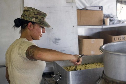 """Spc. Erica Mann, a food service specialist with, from Modesto, Calif., with 2nd Battalion, 502th Infantry Regiment, 2nd Brigade Combat Team, 101st Airborne Division (Air Assault) prepares dinner chow at the intermediate staging base in support of the """"Strike"""" Brigade's Joint Readiness Training Center rotation 16-01, Fort Polk, La., Sept. 26, 2015. (Staff Sgt. Terrance D. Rhodes, 2nd Brigade Combat Team, 101st Airborne Division (Air Assault) Public Affairs)"""