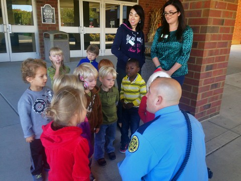 Montgomery County Sheriff's Deputy Joshua Gardner teaches First Baptist First Learners Preschool children about Law Enforcement.
