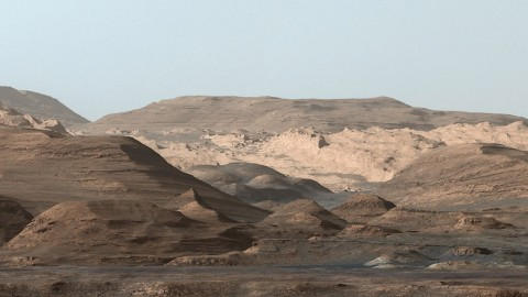 This composite image looking toward the higher regions of Mount Sharp was taken on September 9, 2015, by NASA's Curiosity rover. In the foreground -- about 2 miles (3 kilometers) from the rover -- is a long ridge teeming with hematite, an iron oxide. (NASA/JPL-Caltech/MSSS)