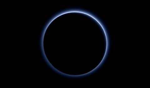 Pluto's Blue Sky: Pluto's haze layer shows its blue color in this picture taken by the New Horizons Ralph/Multispectral Visible Imaging Camera (MVIC). The high-altitude haze is thought to be similar in nature to that seen at Saturn's moon Titan. The source of both hazes likely involves sunlight-initiated chemical reactions of nitrogen and methane, leading to relatively small, soot-like particles (called tholins) that grow as they settle toward the surface. (NASA/JHUAPL/SwRI)
