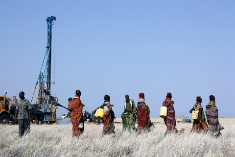 Radar Technologies International's WATEX System uses Landsat data, which contains information on surface topography and rock chemistry, to help locate underground water. Pictured here are Turkana women coming with containers to gather newly discovered water from a drilled well in the Lotikipi basin. (Radar Technologies International)