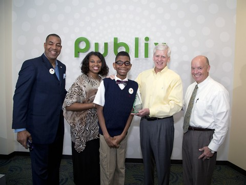 """March of Dimes National Ambassador Family Todd Jackson, Elise Jackson and Elijah Jackson recently presented Publix CEO Ed Crenshaw and President Todd Jones with the Crystal Award for being named the #2 March for Babies National Team in 2014."""