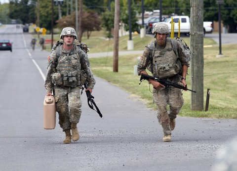 Spc. Kyle Little, a medic with 2nd Battalion, 44th Air Defense Artillery Regiment, 101st Airborne Division Sustainment Brigade, and Sgt. Gaines Sumrall, a medic with 101st Airborne Division Artillery, jog the last leg of the final road march during the 101st Airborne Division Best Medic Competition at Fort Campbell, Ky., Sept. 25, 2015. Little and Sumrall will represent the 101st Airborne Division at the Command Sgt. Maj. Jack L. Clark Jr. Best Medic Competition at Fort Sam Houston, Texas, in November. (Sgt. William White, 101st Airborne Division (Air Assault) Public Affairs)