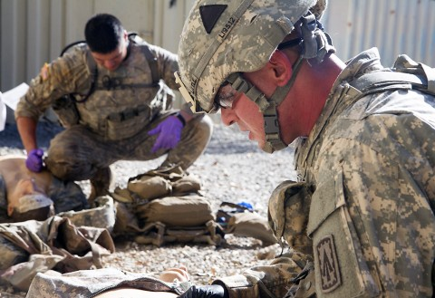 Spc. Kyle Little, right, a medic with 2nd Battalion, 44th Air Defense Artillery Regiment, 101st Airborne Division Sustainment Brigade, 101st Airborne Division (Air Assault), and Sgt. Gaines Sumrall, left, a medic with 101st Airborne Division Artillery, perform tactical medical care during the 101st Airborne Division Best Medic Competition at Fort Campbell, Ky., Sept. 23, 2015. (Sgt. William White, 101st Airborne Division (Air Assault) Public Affairs)
