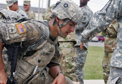 Sgt. Gaines Sumrall, a medic with 101st Airborne Division Artillery, takes a breather after finishing the final foot march of the 101st Airborne Division Best Medic Competition at Fort Campbell, Ky., Sept. 25, 2015. Sumrell, a Beaufort, S.C., native, will represent the 101st Airborne Division with his teammate, Spc. Kyle Little, at the Command Sgt. Maj. Jack L. Clark Jr. Best Medic Competition in Fort Sam Houston, Texas, in November. (Sgt. William White, 101st Airborne Division (Air Assault) Public Affairs)