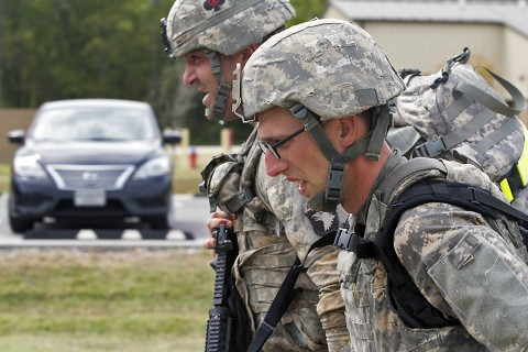 Sgt. Mitchell Holley and Sgt. Benjamin Proctor, medics with 1st Battalion 506th Infantry Regiment, 1st Brigade Combat Team, 101st Airborne Division (Air Assault), close in on the finish line during the 101st Airborne Division Best Medic Competition at Fort Campbell, Ky., Sept. 25, 2015. Holley and Proctor finished as the runner-up team to represent the 101st at the Command Sgt. Maj. Jack L. Clark Jr. Best Medic Competition at Fort Sam Houston, Texas, in November. (Sgt. William White, 101st Airborne Division (Air Assault) Public Affairs)