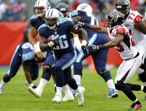 Tennessee Titans running back Antonio Andrews (26) runs for a first down during the first half against the Atlanta Falcons at Nissan Stadium. (Christopher Hanewinckel-USA TODAY Sports)