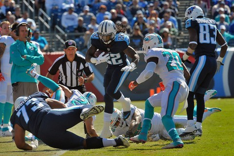 Tennessee Titans running back Dexter McCluster (22) leaps to avoid a tackle against the Miami Dolphins during the first half at Nissan Stadium October 18th, 2015 . (Jim Brown-USA TODAY Sports)