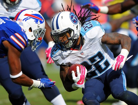 Tennessee Titans running back Dexter McCluster (22) is stopped by Buffalo Bills receiver Robert Woods (10) after a punt return during the second half at Nissan Stadium. The Bills won 14-13. (Christopher Hanewinckel-USA TODAY Sports)