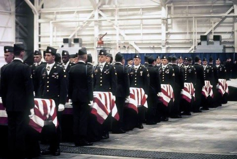 Soldiers from 2nd Brigade Combat Team, 101st Airborne Division (Air Assault), carry the remains of the 248 101st Soldiers who perished in the crash of Arrow Air Flight 1285, Dec. 12, 1985, near Gander International Airport in Newfoundland, Canada. Amy Gallo's late husband, Sgt. Richard S. Nichols, remains are in the third coffin from the left. (Courtesy Photo)