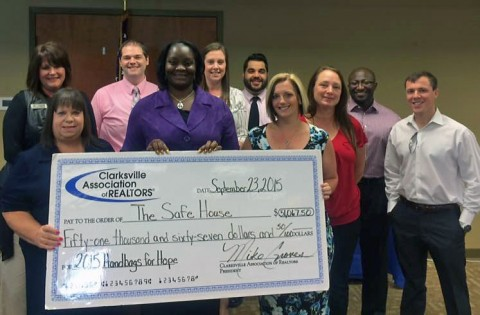 Young Professionals Network presents a check for $51,067 to Urban Ministries' The SafeHouse.