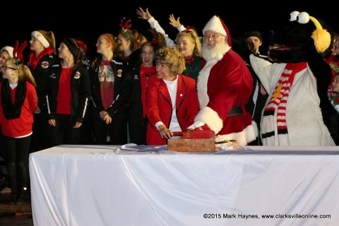 Clarksville Mayor Kim McMillan, Channel 4's Snowbird and Santa Claus flipped the switch turning on the lights for Christmas on the Cumberland.