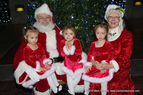 Three well dressed ladies visiting with Santa Claus and Mrs. Claus at Christmas on the Cumberland.
