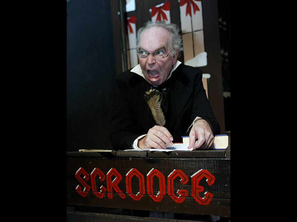 John McDonald as Ebenezer Scrooge in The Roxy Regional Theatre's production of