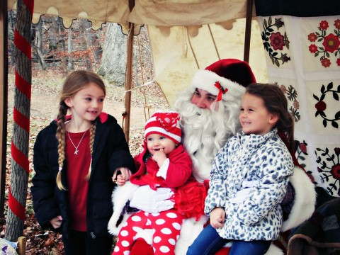 Children sit on Santa's lap to tell him what they would like for Christmas. Join us each year in November at The Homeplace in Land Between The Lakes for an 1850's Christmas. (Keurin Gaffney)